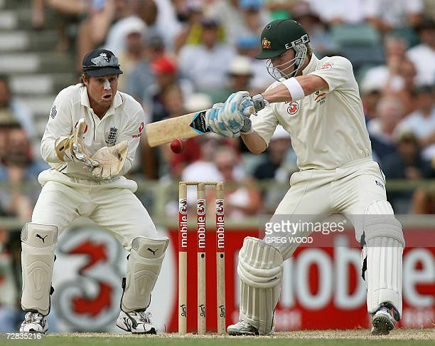 Australian batsman Michael Clarke watched by England wicketkeeper Geraint Jones plays a cut shot on day three of the third Ashes Test against England...