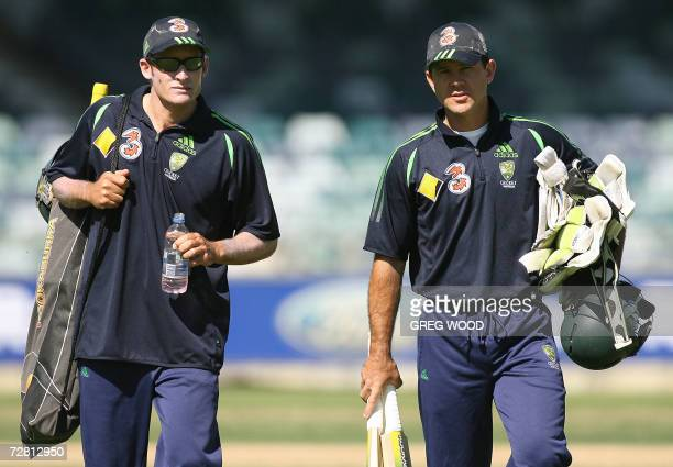 Australian captain Ricky Ponting and teammate Michael Hussey arrive for a training session on the eve of the third Ashes cricket Test against England...