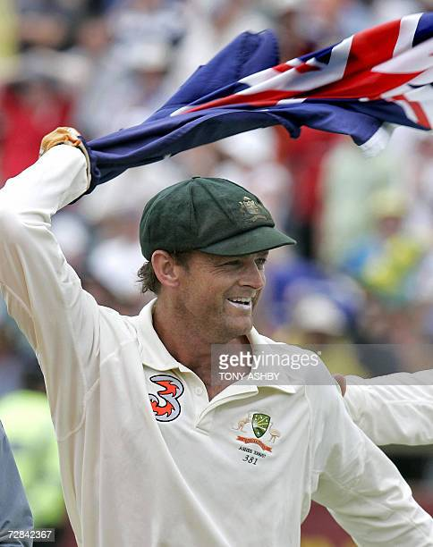 Australian wicketkeeper Adam Gilchrist runs around the WACA with an Australian flag celebrating the third Ashes Test win against England in Perth 18...