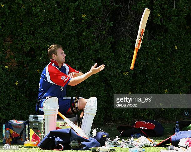 England captain Andrew Flintoff throws his bat to a teammate during a break in a training session on the eve of the third Ashes cricket Test against...