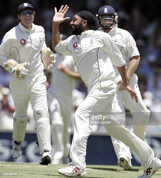 England's Monty Panesar celebrates his first wicket in the series after clean bowling Australian opening batsman Justin Langer for 37 during the...