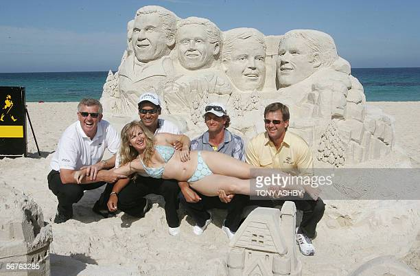 International golfers Colin Montgomerie Michael Campbell Retief Goosen Adam Scott hold sand sculptor Jenny Rossen who immortalised them in sand at...
