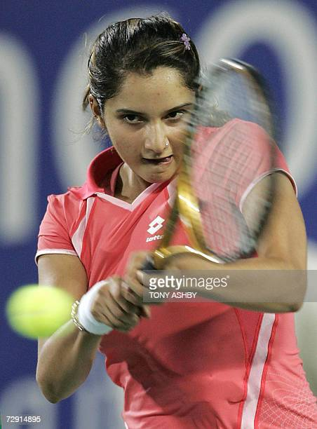 Sania Mirza of India returns to Sanja Ancic of Croatia in their womens singles match at the XIX Hopman Cup held in Perth, 03 January, 2007. Mirza...