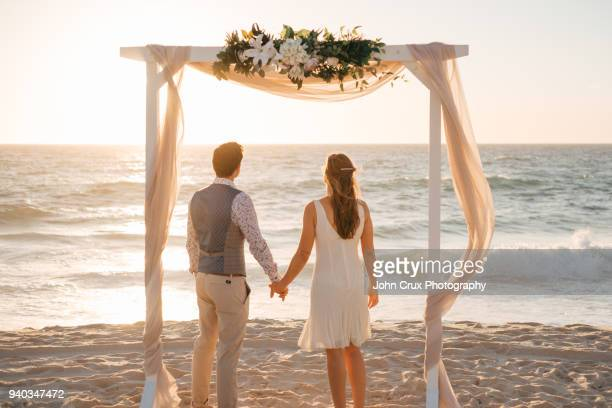 perth beach wedding couple - wedding stock pictures, royalty-free photos & images