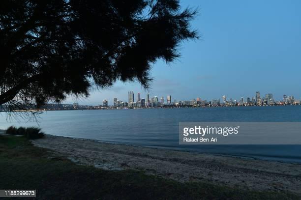 perth central business district skyline at sunset western australia - rafael ben ari fotografías e imágenes de stock