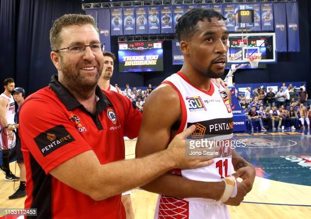 Perth coach Trevor Gleeson and Perth player Bryce Cotton celebrate the win after game two of the NBL Semi Final Series between the Brisbane Bullets...