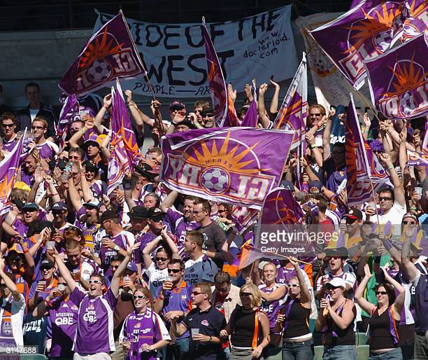 Perth Glory crowd celebrates after a goal during the NSL Finals match between Perth Glory and Adelaide United at Subiaco Oval March 28 2004 in Perth...