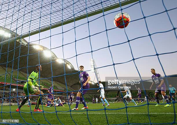 Perth Glory goalkeeper Ante Covic is beaten by a shot from Bruno Fornaroli of Melbourne City during the ALeague Elimination Final match between...
