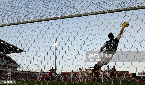 Perth Glory goalkeeper Daniel Vukovic dives for the ball during the round 13 ALeague match between the Newcastle Jets and Perth Glory at Hunter...