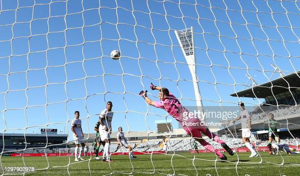 Perth Glory goalkeeper Liam Reddy Perth Glory is beaten by a shot from Victor Sanchez of Western United during the A-League match between Western...