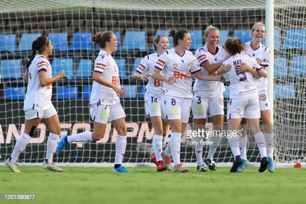 Perth Glory players celebrate a goal during the round 11 W-League match between the Newcastle Jets and the Perth Glory at McDonald Jones Stadium on...