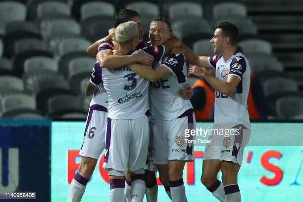 Perth Glory players celebrate a goal during the round 24 ALeague match between the Central Coast Mariners and the Perth Glory at Central Coast...