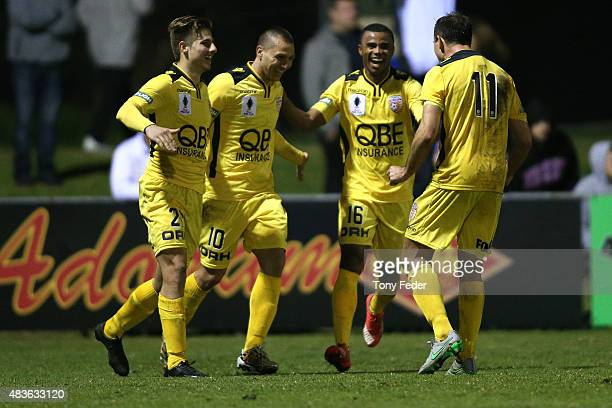 Perth Glory players celebrate a goal in extra time during the FFA Cup match between Newcastle Jets and Perth Glory at Magic Park Broadmeadow on...