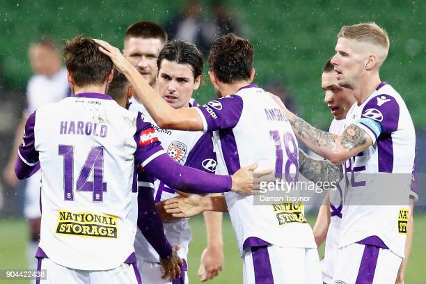 Perth Glory players celebrates a Diego Castro goal during the round 16 ALeague match between the Melbourne Victory and Perth Glory at AAMI Park on...
