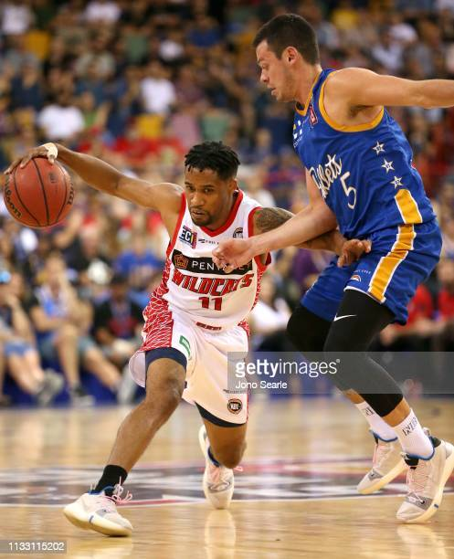 Perth player Bryce Cotton competes with Bullets player Jason Cadee during game two of the NBL Semi Final Series between the Brisbane Bullets and the...