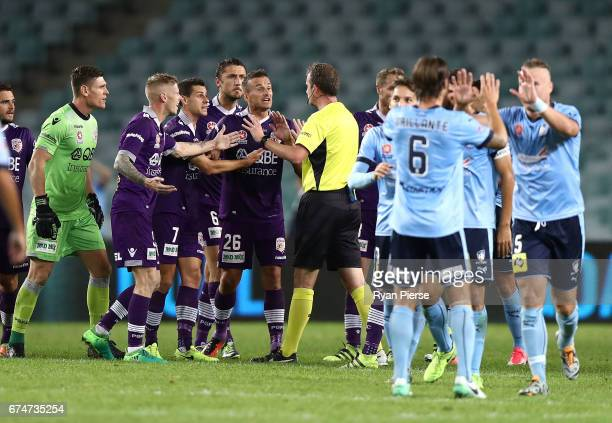 Perth players surround referee Peter Green after a video referee decision during the ALeague Semi Final match between Sydney FC and the Perth Glory...