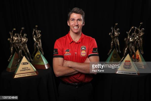 Perth Wildcats Captain Damian Martin poses with his 6 NBL Championship Trophies after announcing his retirement during a Perth Wildcats NBL media...