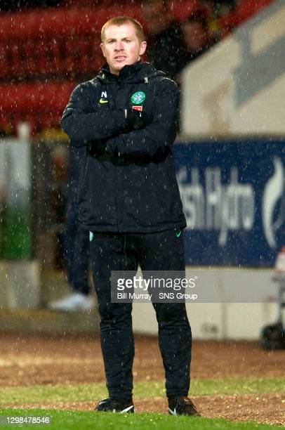 Celtic boss Neil Lennon braves the elements to watch his side cling on to victory