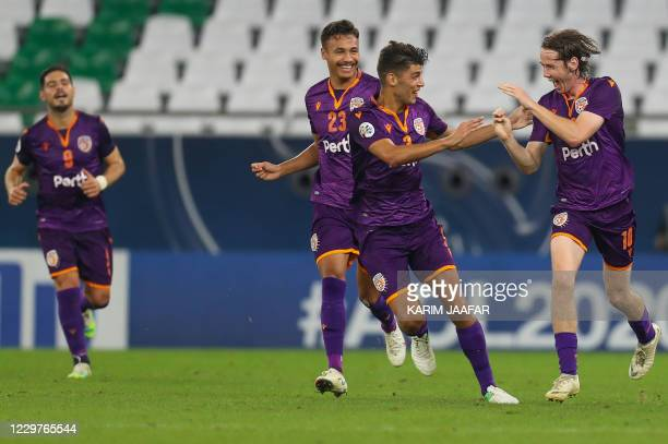 Perth's midfielder Daniel Stynes celebrates his goal with teammates during the AFC Champions League group F football match between Australia's Perth...