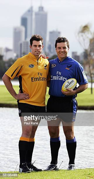 Perth's Western Force players Lachlan MacKay in the new away jersey and Brendan Cannon in the new home jersey pose at Burswood Resort on July 5 2005...