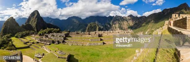 Peru, Andes, Urubamba Valley, Machu Picchu with mountain Huayna Picchu, Main Square and temple of three windows