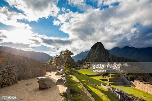 Peru, Andes, Urubamba Valley, Machu Picchu with mountain Huayna Picchu at sunset