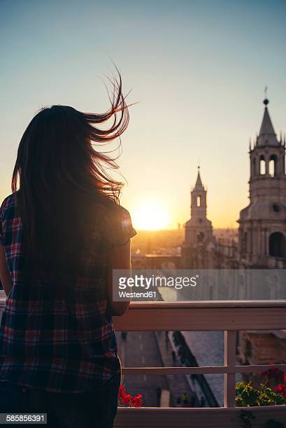 Peru, Arequipa, woman looking at Plaza de Armas enjoying sunset