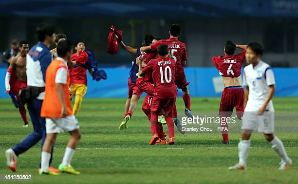 Peru celebrates after they defeated Korea Republic 21 in the final match during the 2014 FIFA Boys Summer Youth Olympic Football Tournament...