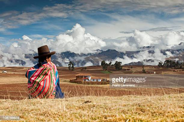 Peru, Chinchero, Indian woman and mountains