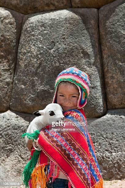 Peru, Cuzco, Indian girl with lamb