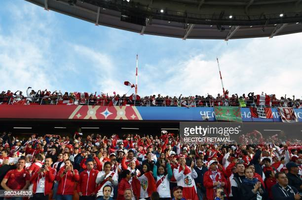 Peru fans attend the Russia 2018 World Cup Group C football match between France and Peru at the Ekaterinburg Arena in Ekaterinburg on June 21 2018 /...