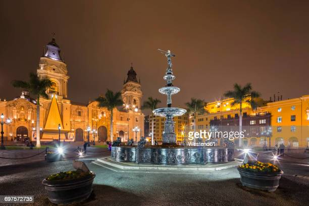 Peru, Lima, Plaza de Armas, Cathedral of Lima and fountain at night