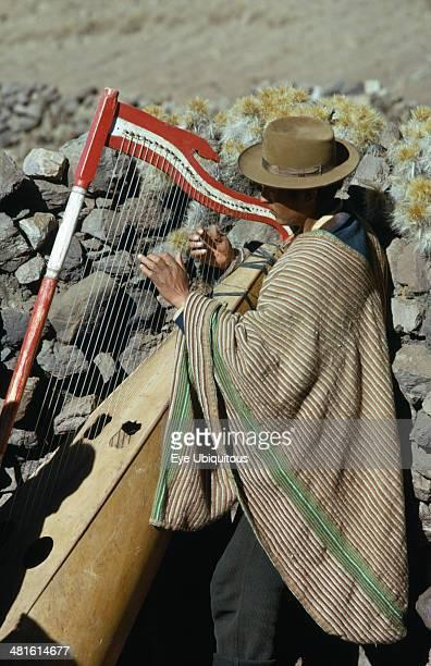 Peru Music Quechua Indian man playing traditional harp