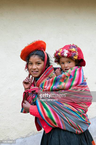 Peru, Patacancha, Indian girl carrying baby