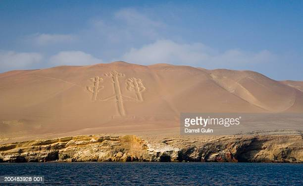 peru, pisco, paracas national reserve, candelabro drawn in sand dune - pisco peru stock photos and pictures