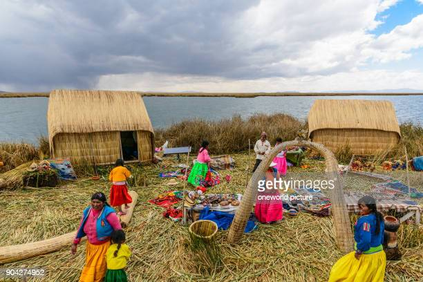 Peru Puno boat trip to the Uros which live on floating islands of reeds on the lake They live by agriculture and tourism