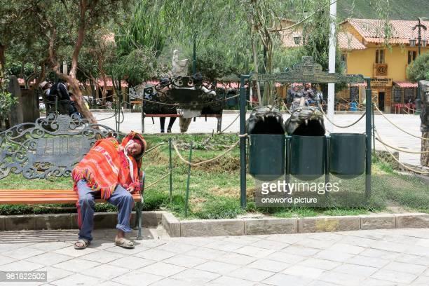 Peru. Qosqo. Ollantaytambo. Sleeping man in Ollantaytambo.