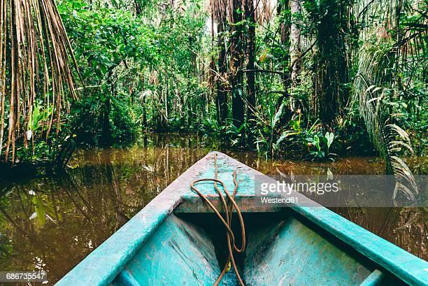 peru, tambopata, boat on amazon river - río amazonas fotografías e imágenes de stock