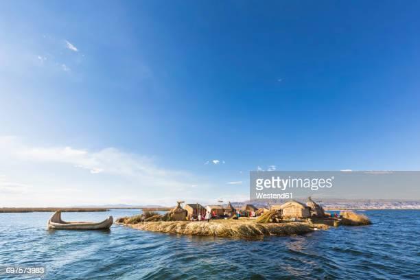 Peru, Titicaca lake, Uros Floating Island and boat made of giant bulrush