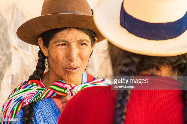 Peru: Two Quechua Women Deep in Conversation (Close-Up), Ollantaytambo