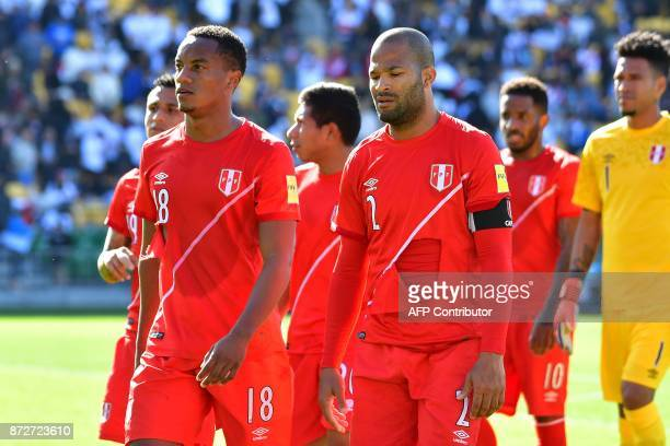 Peru's Alberto Rodriguez and Andre Carrillo walk from the field at halftime during the World Cup football qualifying match between New Zealand and...