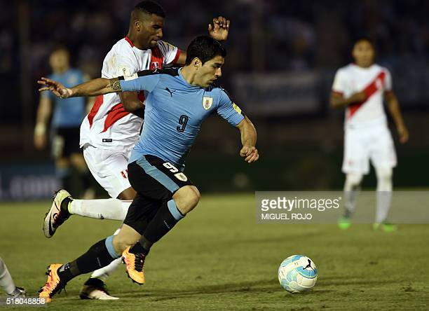 Peru's Alberto Rodriguez and Uruguay's Luis Suarez vie for the ball during their Russia 2018 FIFA World Cup South American Qualifiers' football match...