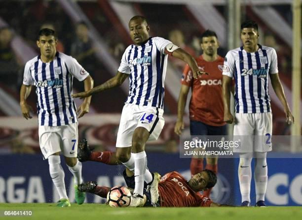 Peru's Alianza Lima midfielder Luis Ramirez vies for the ball with Argentina's Independiente midfielder Walter Erviti during their Copa Sudamericana...