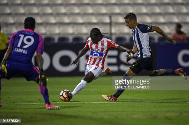 Peru's Alianza Lima player Gonzalo Godoy tries to stop Colombia's Junior Yimmi Chara during their 2018 Copa Libertadores football match at the...