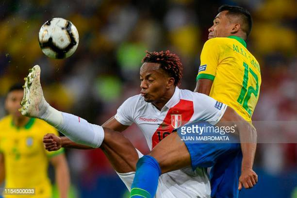 TOPSHOT Peru's Andre Carrillo and Brazil's Alex Sandro vie for the ball during their Copa America football tournament final match at Maracana Stadium...