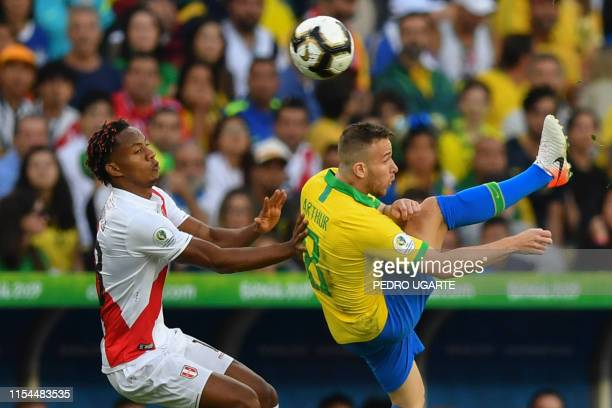 Peru's Andre Carrillo and Brazil's Arthur vie for the ball during their Copa America football tournament final match at Maracana Stadium in Rio de...