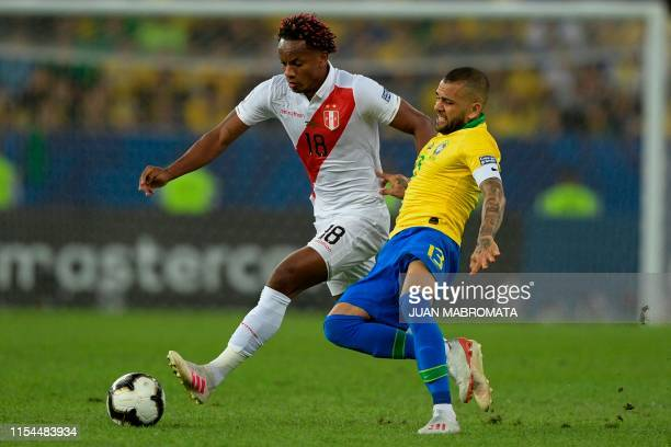 Peru's Andre Carrillo and Brazil's Dani Alves vie for the ball during their Copa America football tournament final match at Maracana Stadium in Rio...