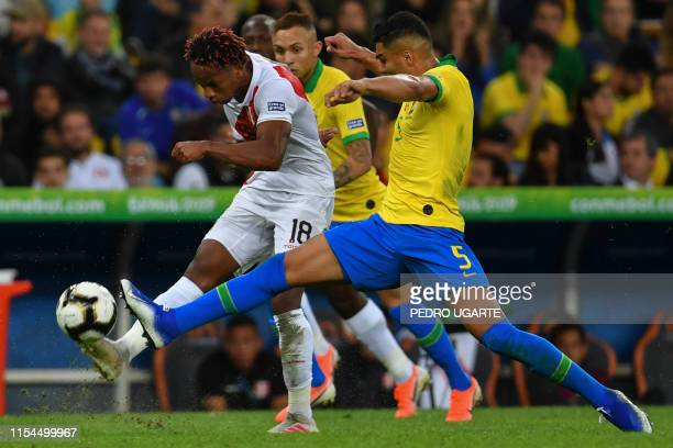 Peru's Andre Carrillo is marked by Brazil's Casemiro during their Copa America football tournament final match at Maracana Stadium in Rio de Janeiro...