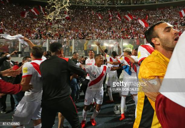 Peru's Andy Polo celebrates with teammates and supporters after defeating New Zealand by 20 and qualifying for the 2018 football World Cup in Lima...
