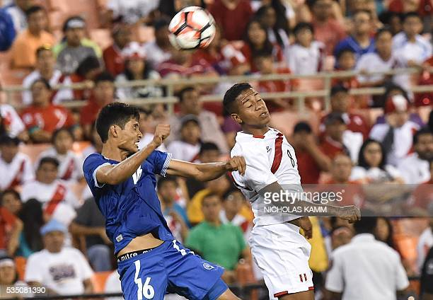Peru's Andy Polo vies with El Salvador 's Andres Flores during an international friendly football match at RFK Stadium in Washington DC on May 28...
